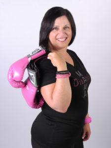 Nadine holding pink gloves